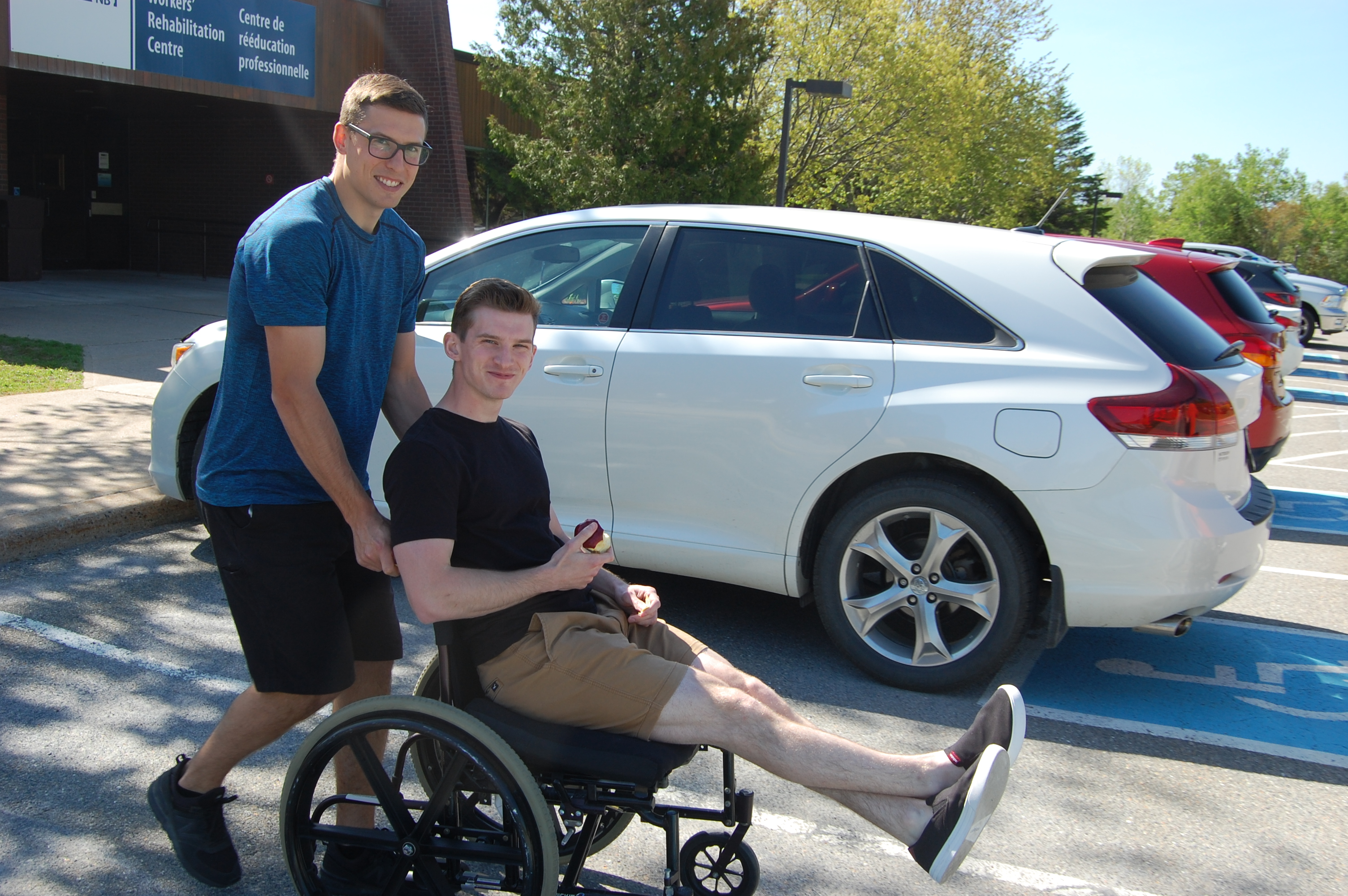 WorkSafeNB occupational therapist Andy West helps summer student Brandon Sloot navigate his wheelchair around WorkSafeNB's Rehabilitation Centre in Grand Bay-Westfield.
