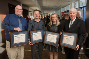 WorkSafeNB announced the recipients of its 2018 Safety Star Awards at its annual Health and Safety Conference in Fredericton on Friday, October 5. From left: <b>Benjamin Kelly</b>, Health and Safety Educator Award (anglophone) recipient, Caledonia Regional High School; <b>Ricky Laboissonnière</b>, Health and Safety Educator Award (francophone) recipient, École Louis-J.-Robichaud; Nikol Ralcheva, Health and Safety Leader Award, Fredericton Multicultural Association; <b>Peter Morgan</b>, Health and Safety Champion Award recipient, City of Saint John. <i>Photo: Stephen MacGillivray/For WorkSafeNB</i>